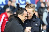 Pictured L-R: Formet team mates, Everton manager Roberto Martinez and Swansea head coach Garry Monk. Sunday 16 February 2014<br /> Re: FA Cup, Everton v Swansea City FC at Goodison Park, Liverpool, UK.