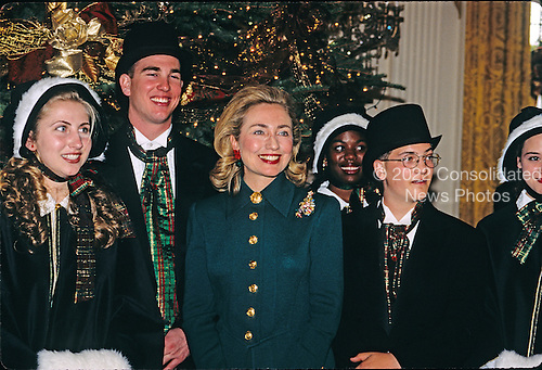 First lady Hillary Rodham Clinton poses with the Las Vegas Academy Madrigals from Las Vegas, Nevada during a preview for the press of the White House Christmas decorations in the East Room of the White House in Washington, D.C. on December 4, 1995.<br /> Credit: Ron Sachs / CNP