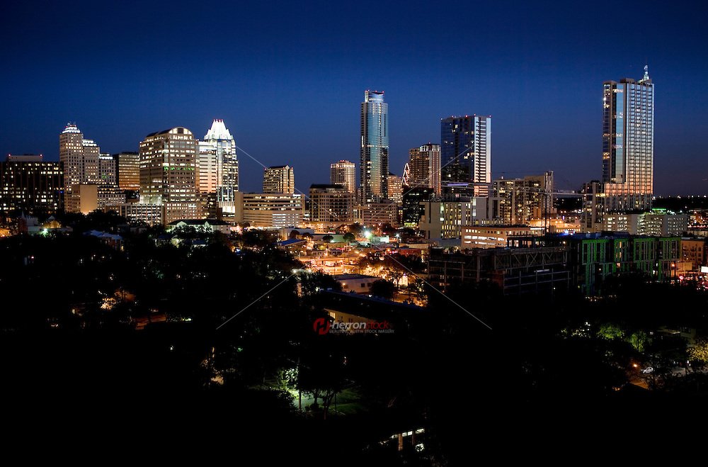 Night surrounds the new Downtown Austin Skyline and cityscape looking West along a myriad of skyscapers.