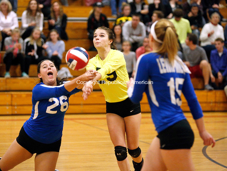 Winsted, CT- 09 November 2016-110916CM10-  Lewis Mills Samantha Furst (26) goes in for the ball with teammate Sarah Wall during their state tournament matchup against Lewis Mills in Winsted on Wednesday. Also in the play is teammate Hayley Tharau (15).       Christopher Massa Republican-American