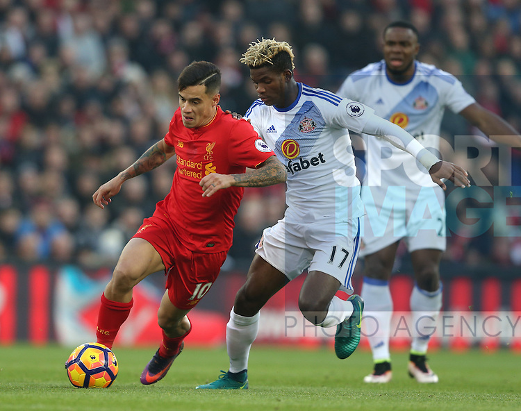 Philippe Coutinho of Liverpool tussles with Didier Ndong of Sunderland during the Premier League match at the Anfield Stadium, Liverpool. Picture date: November 26th, 2016. Pic Simon Bellis/Sportimage