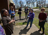 NWA Democrat-Gazette/ANDY SHUPE<br /> Deniece Smiley (left), Fayetteville Housing Authority director, leads a tour Friday, March 30, 2018, of Lewis Plaza, a property that the authority directs, for the organization's board of directors and members of the public in Fayetteville. The board this year has to come up with a capital improvements plan, per U.S. Department of Housing and Urban Development regulations.