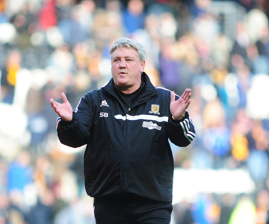 Hull City's Manager Steve Bruce applauds the Hull City fans at the end of the game<br /> <br /> Photographer Chris Vaughan/CameraSport<br /> <br /> Football - Barclays Premiership - Hull City v Everton - Sunday 11th May 2014 - Kingston Communications Stadium - Hull<br /> <br /> &copy; CameraSport - 43 Linden Ave. Countesthorpe. Leicester. England. LE8 5PG - Tel: +44 (0) 116 277 4147 - admin@camerasport.com - www.camerasport.com