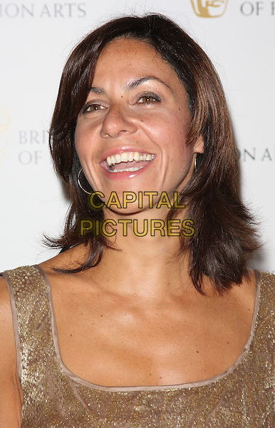 JULIA BRADBURY .British Academy Television Craft Awards at the Hilton, Park Lane, London, England, UK, May 23rd 2010.BAFTA portrait headshot smiling mouth open gold .CAP/ROS.©Steve Ross/Capital Pictures