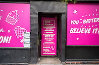 Signs promote the as yet unopened Sweets By Chloe next door to the popular By Chloe vegan fast casual dining restaurant on Bleecker Street in Greenwich Village in New York Thursday, June 23, 2016. The restaurant, created by Chloe Coscarelli, is opening an outpost in the Flatiron District in New York. She is a partner with Samantha Wasser of ESquared Hospitality which perversely owns the BLT Steak franchise. (© Richard B. Levine)