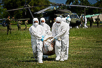 Colombian judicial police transport the remains of FARC rebels killed during a dawn attack in Meta, at the Military Base Apiay in Villavicencio, Colombia. 27/03/2012.  Photo by Nestor Silva / VIEWpress.