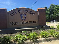 NWA DEMOCRAT GAZZETTE/TRACY M. NEAL Sign for Rogers Police Department
