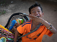 A happy local Khmer boy who is a street vendor at Angkor Wat giving me a happy smile, Cambodia