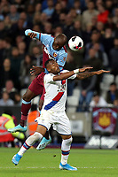 Jordan Ayew of Crystal Palace and Angelo Ogbonna of West Ham United during West Ham United vs Crystal Palace, Premier League Football at The London Stadium on 5th October 2019