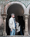 Sintra, Portugal. 17.04.2016. A man looks through the interior arches at Pena Palace, Sintra. Photograph © Jane Hobson.