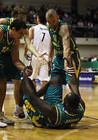 Nathan Jawai's Boomers teammates help him up during the International basketball match between the NZ Tall Blacks and Australian Boomers at TSB Bank Arena, Wellington, New Zealand on 25 August 2009. Photo: Dave Lintott / lintottphoto.co.nz