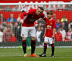 Wayne Rooney of Manchester United guides the mascot during the pre match during the English Premier League match at the Old Trafford Stadium, Manchester. Picture date: May 21st 2017. Pic credit should read: Simon Bellis/Sportimage