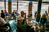 CANADA, Vancouver, British Columbia, passengers enjoy a meal while cruising the inside passage on the way to Ketchikan, Georgia Straight, Holland America Cruise Ship the Oosterdam
