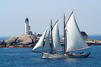Schooner passing White Island Lighthouse, Isles of Shoals, New Hampshire. Photograph by PeterE. Randall.
