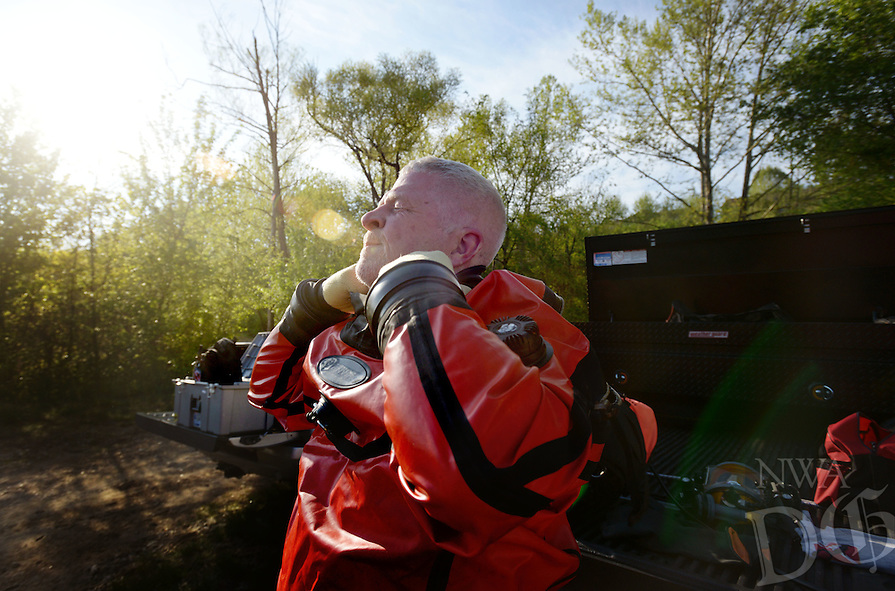 NWA Democrat-Gazette/BEN GOFF @NWABENGOFF<br /> Rick Downum with the Benton County Dive Team suits up on Sunday April 24, 2016 to help retrieve a vehicle from Beaver Lake at the Highway 12 bridge public access area East of Rogers. No one was in the Volvo sedan when it rolled into the lake, sinking in water that was 7-10 feet deep according to the dive team.