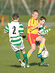 Jamie Roche of Avenue United in action against 2 of Knocklyon FC during their SFAI game at Lisdoonvarna. Photograph by John Kelly.
