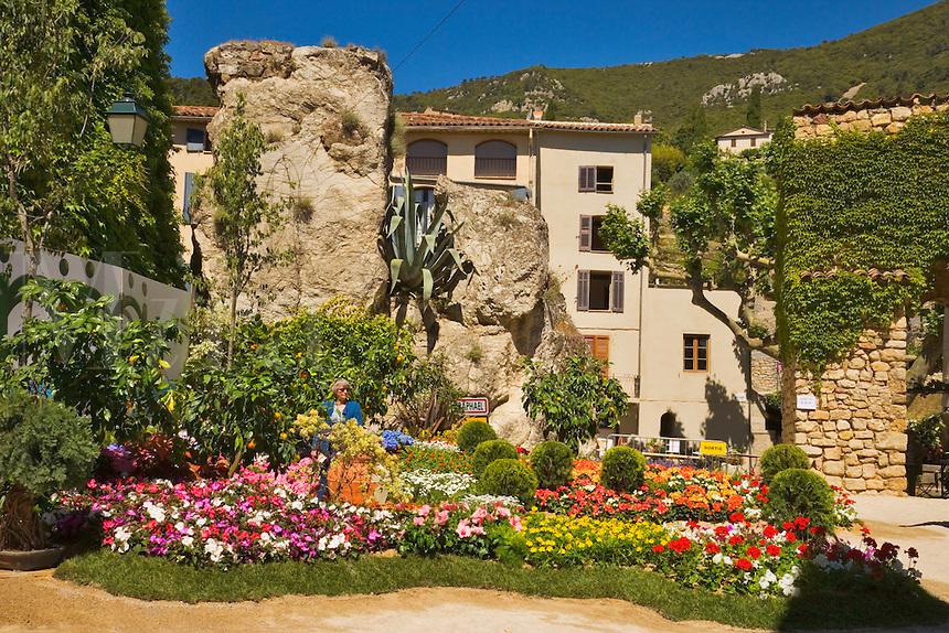 Corner of the village of Seillans during the Flower Festival.  Porte Sarrazine and Hotel des Deux Rocs. Var, Provence, France.