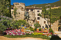 Corner of the village of Seillans during the Flower Festival.  Porte Sarrazine and Hotel des Deux Rocs. Var, Provence, France.