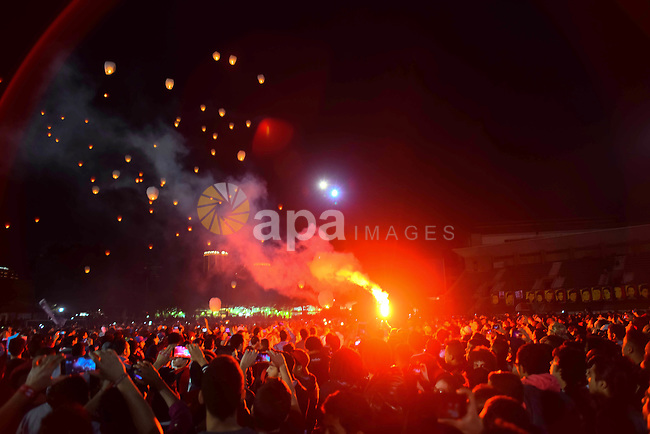 "Al Ahly fans, also known as ""Ultras"", light flares and shout slogans at al-Ahly club's training stadium marking the fourt anniversary of killing al-Ahly fans in what known as the ""Port Said massacre"", on February 1, 2016. On 1 February 2012, a massive riot occurred at Port Said Stadium in Port Said city, Egypt, following an Egyptian Premier League football match between El Masry and El Ahly clubs. At least 74 people were killed and more than 500 were injured after thousands of El Masry spectators stormed the stadium stands and the pitch. Photo by Amr Sayed"