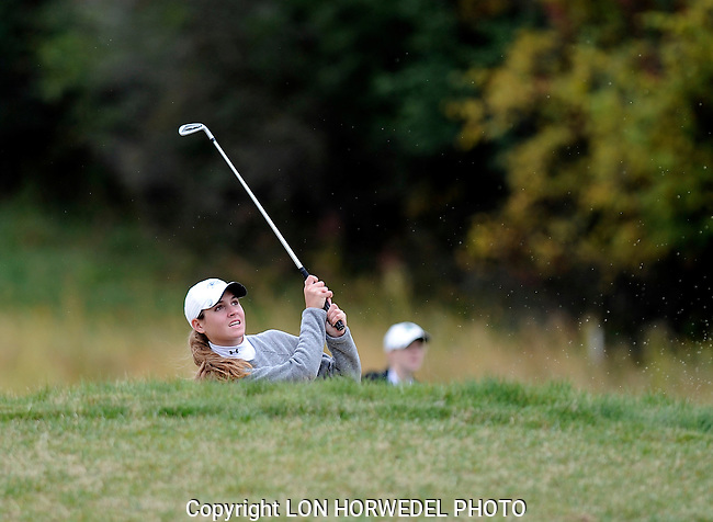 Ann Arbor High School's annual girl's golf city tourney at Barton Hills C.C., Tuesday, September 30, 2014.