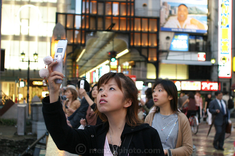 Camera-cellphone culture in Osaka, Japan. (Supporting image from the project Hungry Planet: What the World Eats.)