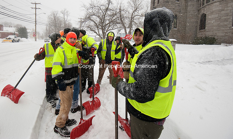 WINSTED,  CT-020215JS06-  Workers from B&amp;D Landscaping discuss their next job after clearing snow from the First Church of Winsted during Monday's snowfall. Nearly a foot of snow fell in some parts of the area. <br /> Jim Shannon Republican-American