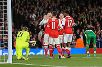 Mesut Ozil of Arsenal (11) celebrates scoring his third goal against Ludogorets Razgrad to make it 6-0 during the UEFA Champions League match between Arsenal and PFC Ludogorets Razgrad at the Emirates Stadium, London, England on 19 October 2016. Photo by David Horn / PRiME Media Images.