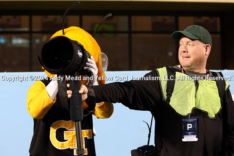 18 October 2014: Georgia Tech mascot Buzz takes over from Getty photographer Grant Halverson. The University of North Carolina Tar Heels hosted the Georgia Tech Yellow Jackets at Kenan Memorial Stadium in Chapel Hill, North Carolina in a 2014 NCAA Division I College Football game. UNC won the game 48-43.