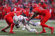 College Park, MD - November 12, 2016: Ohio State Buckeyes running back Curtis Samuel (4) is tackled by several Maryland Terrapins defenders during game between Ohio St. and Maryland at  Capital One Field at Maryland Stadium in College Park, MD.  (Photo by Elliott Brown/Media Images International)