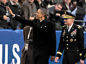 United States President Barack Obama gestures as he walks to the Army side of the field during halftime of the 112th meeting of the United States Army Black Knights and the U.S. Navy Midshipmen on the Navy side of the field at FedEx Field in Landover, Maryland on Saturday, December 10, 2011.  Lieutenant General David H. Huntoon, Jr., Director of the Army Staff, U.S. Army, is at right..Credit: Ron Sachs / CNP