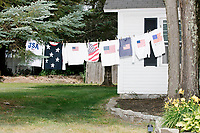 American flag t-shirts hang from a tree in Amherst, New Hampshire, on Thu., July 4, 2019.