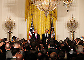 United States President Barack Obama makes remarks next to U.S. Vice President Joe Biden at the LGBT Pride Month celebration in the East Room at the White House on June 13, 2013.  <br /> Credit: Molly Riley / Pool via CNP