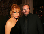 "Country Singer Reba McEntire poses with her husband Narvel at the 15th Annual QVC presents ""FFANY Shoes on Sale"" which benefits Breast Cancer Research on October 15, 2008 at the Waldorf Astoria, New York City, New York. (Photo by Sue Coflin/Max Photos)"
