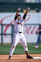 Oregon State Beavers Cesar Valero Sanchez (8) celebrates after hitting a double during an NCAA game against the New Mexico Lobos at Surprise Stadium on February 14, 2020 in Surprise, Arizona. (Zachary Lucy / Four Seam Images)