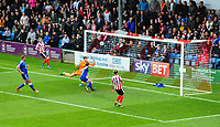 Chesterfield's Andy Kellett deflects a cross from Lincoln City's Harry Anderson past Chesterfield's Joe Anyon to gift Lincoln City their second goal<br /> <br /> Photographer Chris Vaughan/CameraSport<br /> <br /> The EFL Sky Bet League Two - Lincoln City v Chesterfield - Saturday 7th October 2017 - Sincil Bank - Lincoln<br /> <br /> World Copyright &copy; 2017 CameraSport. All rights reserved. 43 Linden Ave. Countesthorpe. Leicester. England. LE8 5PG - Tel: +44 (0) 116 277 4147 - admin@camerasport.com - www.camerasport.com