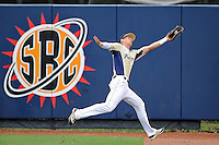 4 March 2012:  FIU outfielder Nathan Burns (6) makes a leaping catch early in the game as the FIU Golden Panthers defeated the Brown University Bears, 8-3, at University Park Stadium in Miami, Florida.