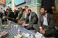 Iranian President Mahmoud Ahmadinejad sits and shares a meal with the families of martyrs from the Iran-Iraq War. These dinners are staples of Ahmadinejad's provinvial visits.