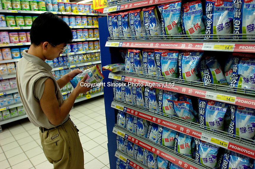 Nestle milk powder new products especially for students are on sale with a promotion in a Carrefour supermarket in Beijing, China. Major international chains like Carrefour and Walmart Stores have expanded aggressively in China. Local Chinese retailers have loudly protested this and lobbied heavily for protection from the new competition in price and service that these major retailers have set off..22 Jul 2006