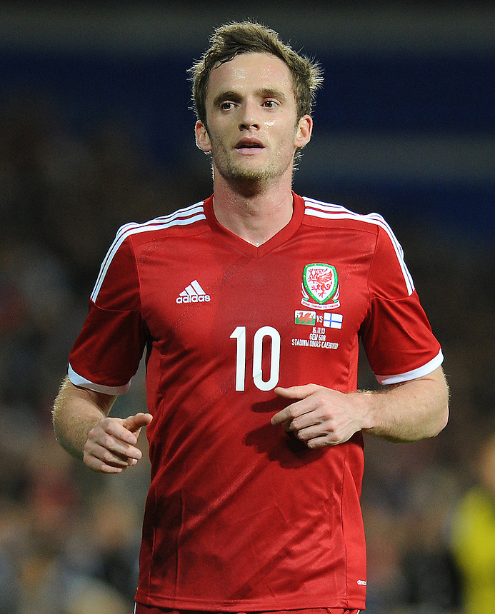 Wales Andy King in action during todays match  <br /> <br /> Photo by Ashley Crowden/CameraSport<br /> <br /> Football - International Friendly - Wales v Finland - Saturday 16th November 2013 - Cardiff City Stadium - Cardiff<br /> <br /> &copy; CameraSport - 43 Linden Ave. Countesthorpe. Leicester. England. LE8 5PG - Tel: +44 (0) 116 277 4147 - admin@camerasport.com - www.camerasport.com