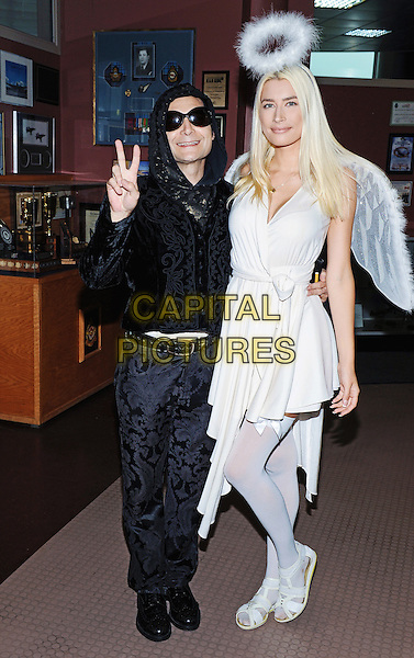 01 October 2016 - Hamilton, Ontario, Canada.  Actor/singer Corey Feldman with girlfriend 'Angel' Courtney Anne Mitchell at Hamilton Comic Con at the Canadian Warplane Heritage Museum. <br /> CAP/ADM/BPC<br /> &copy;BPC/ADM/Capital Pictures