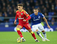 23rd  November 2019; Goodison Park , Liverpool, Merseyside, England; English Premier League Football, Everton versus Norwich City; Max Aarons of Norwich City controls the ball chased by Richarlison of Everton   Strictly Editorial Use Only. No use with unauthorized audio, video, data, fixture lists, club/league logos or 'live' services. Online in-match use limited to 120 images, no video emulation. No use in betting, games or single club/league/player publications