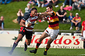 Samisoni Fisilau tries to break past Stephen Donald. Air New Zealand Cup Rugby Game between Counties Manukau & Waikato, played at Bayer Growers Stadium Pukekohe on Saturday August 29th 2009. Waikato won 30 - 8.