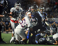 Central Bucks South's Nate Norris #39 drives towards the end zone as Central Bucks East's Nate Ventresca #55 drags him down in the first quarter Friday, September 16, 2016 at Central Bucks West in Doylestown, Pennsylvania. He scored on the next play. CB South defeated CB East 27-6. (Photo by William Thomas Cain)