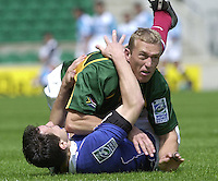 24/05/2002 (Friday).Sport -Rugby Union - London Sevens.South Africa vs France.Jerome Daret (FRA)? and Anton Pitout SA[Mandatory Credit, Peter Spurier/ Intersport Images].