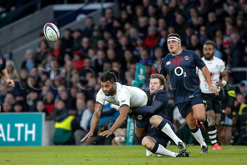 19.11.2016. Twickenham, London, England. Autumn International Rugby. England versus Fiji.  Metuisela Talebula of Fiji offloads as Elliot Daly of England makes the tackle.   Final score: England 58-15 Fiji.