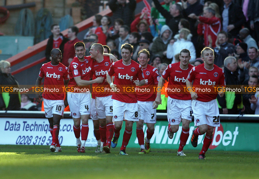 Michael Morrison of Charlton Athletic celebrates with team mates after scoring the opening goal - Charlton Athletic vs Stevenage - nPower League One Football at the Valley, London - 25/02/12 - MANDATORY CREDIT: Helen Watson/TGSPHOTO - Self billing applies where appropriate - 0845 094 6026 - contact@tgsphoto.co.uk - NO UNPAID USE.