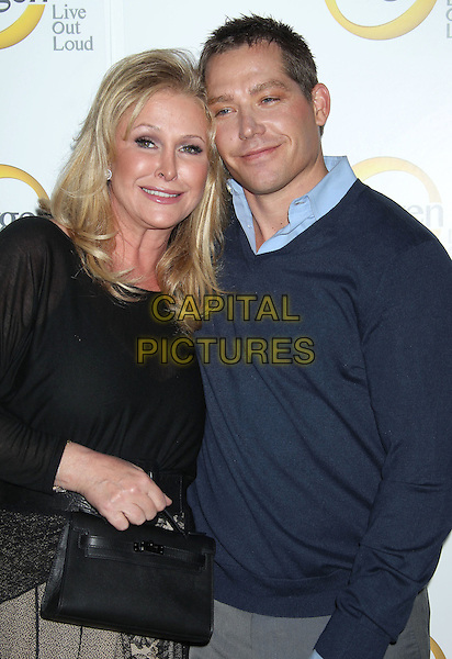 "KATHY HILTON & CY WAITS .""The World According To Paris"" Series Premiere Party Held At The Roosevelt Hotel, Hollywood, CA, USA, .17th May 2011..half length black dress top long sleeve hermes bag blue jumper sweater .CAP/ADM/RE.©Russ Elliot/AdMedia/Capital Pictures."