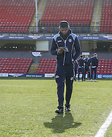 Goalkeeper Jamal Blackman of Wycombe Wanderers reads the matchday programme as he checks the pitch ahead of the Sky Bet League 2 match between Grimsby Town and Wycombe Wanderers at Blundell Park, Cleethorpes, England on 4 March 2017. Photo by Andy Rowland / PRiME Media Images.