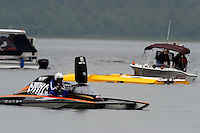 "Pierre Mahaeu in the GP-46 breaks down after the finish line where he is struck from behind by Jimmy Shane in the GP-7 ""Long Gone"" at an estimated 110 MPH. Shane's boat drives pieces of Mahaeu's engine through the rear of the cockpit of the GP-46 before flipping upside down. The unconscious Shane was rescued from his hull by the safety team while Mahaeu was trapped in the collapsed cockpit of his boat which was towed to shore where he was cut from the cockpit after more than an hour. Both drivers were awake and alert when transported to local hospitals..Syracuse Hydrofest, Onondaga Lake, Syracuse, NY.20/21 June, 2009, Dayton, OH USA..©F. Peirce Williams 2009 USA.F.Peirce Williams.photography.ref: RAW (.NEF) File Available"