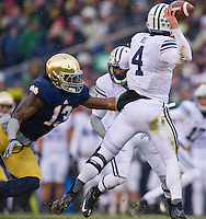 Jaylon Smith (13) pressures BYU Cougars quarterback Taysom Hill (4) in the first quarter.
